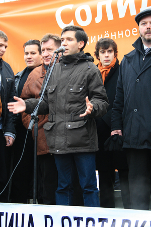 resignation: Moscow, Russia - February 21, 2009.  The oppositionist Oleg Kozlovsky speaks at a rally against Putin. The rally of the opposition movement solidarity with the demand of Putins Government in resignation