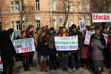 slogans: Moscow, Russia - April 11, 2016.  The protest of students and professors of the Russian Timiryazev State Agrarian University against the exclusion of scientific fields of development. Students and teachers with slogans in defense of the Timiryazev Academy