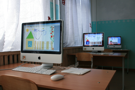 Kirov oblast, Russia - February 2, 2010. Apple Computers in a boarding school for children. Drawings made by children with mental disabilities