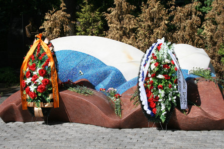 Moscow, Russia - August 21, 2010. Monument to Boris Yeltsin with wreaths from the defenders of democracy. Novodevichy cemetery. On the anniversary of the 1991 coup defenders of democracy laid flowers and wreaths