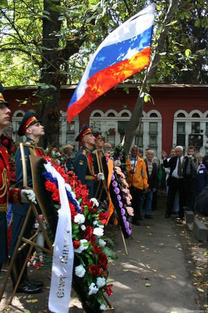 Moscow, Russia - August 21, 2010. The grave of Yegor Gaidar and honor guard. Novodevichy cemetery. On the anniversary of the 1991 coup defenders of democracy laid flowers and wreaths