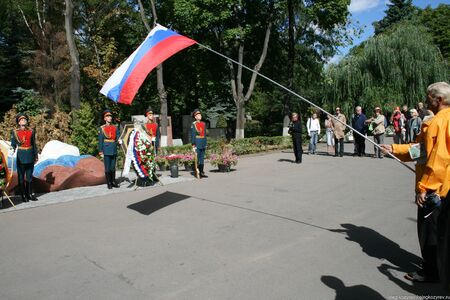 Moscow, Russia - August 21, 2010. unknown party ceremony with a flag over the grave of Boris Yeltsin. Novodevichy cemetery. On the anniversary of the 1991 coup defenders of democracy laid flowers and wreaths