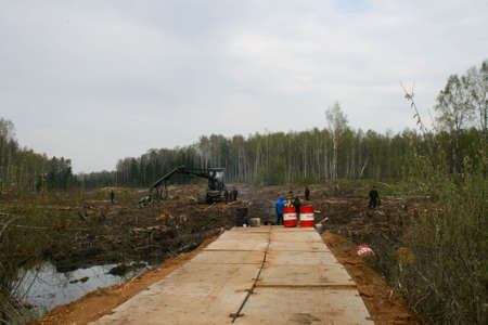 Mechanical harvester sawmill at the site of cutting down the Khimki forest