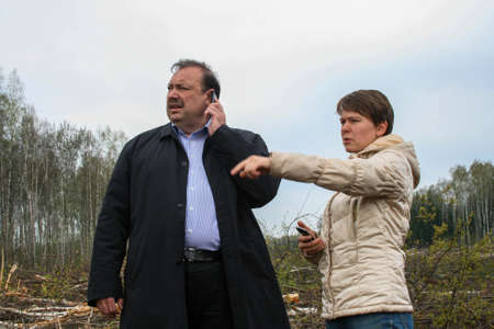 Politician deputy Gennady Gudkov and ecologist Yevgenia Chirikova inspect a clearing in the Khimki forest