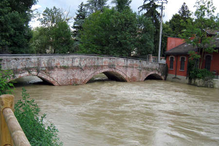 attempts: river running through the ancient bridge and housing