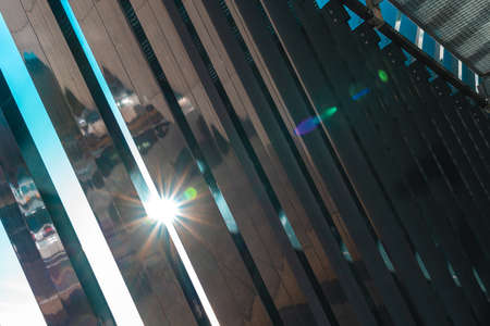 Reflections of the sun entering a corridor of a modern architecture building