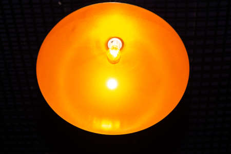 light bulb in the middle of the yellow circle