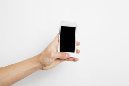 multi touch: Hand holding Smartphone with Blank Screen Stock Photo