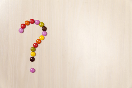 signo de interrogacion: Question mark made by candy pills with text space