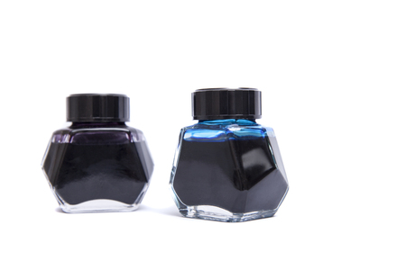 ink well: Two Fountain Pen Ink Bottles Isolated on White