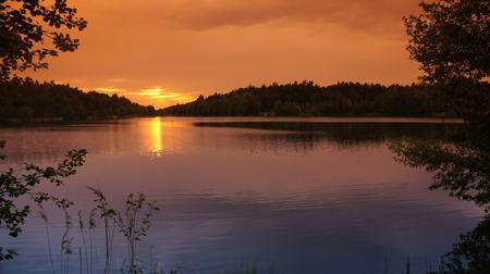 The Sun with lake And Orange Sky.