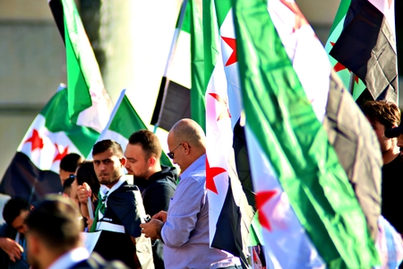 Berlin Germany Tuesday, October 1, 2019: Protest action of the Syrian contraposition near Brandenburg Gate against the Russian in syrian Army. and opposed to Bashar al-Assad. Standard-Bild - 133265398