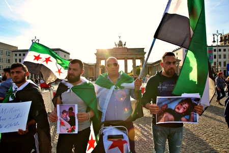 Berlin Germany Tuesday, October 1, 2019: Protest action of the Syrian contraposition near Brandenburg Gate against the Russian in syrian Army. and opposed to Bashar al-Assad. Standard-Bild - 133265414