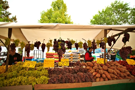 Berlin Germany. SEPTEMBER 09, 2019: Sales of fresh vegetables and fruits in center vegetable outdoor market. Editorial