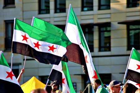 Berlin Germany Tuesday, October 1, 2019: Protest action of the Syrian contraposition near Brandenburg Gate against the Russian in syrian Army. and opposed to Bashar al-Assad.