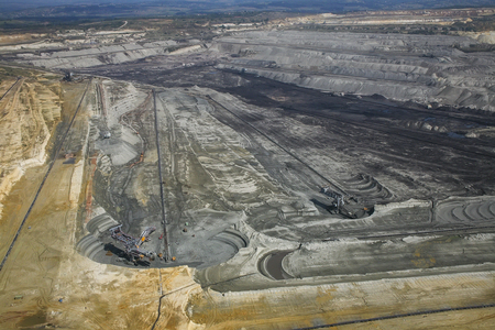 Large excavators in coal mine, aerial view photo