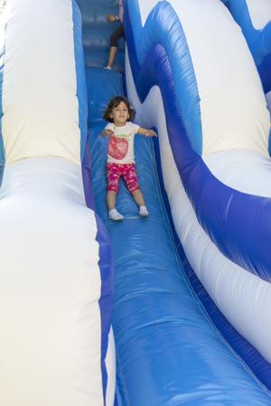 Girl on the slide photo