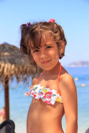 Little girl on the beach photo