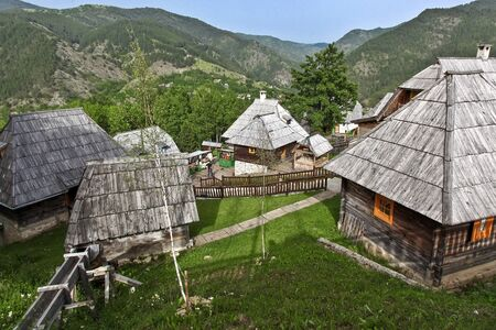 DRVENGRAD, SERBIA - MARCH 29, 2010: Drvengrad is a traditional village that the Serbian film director Emir Kusturica built for his film Life Is a Miracle.It is a ethno-village in mountain nature park Mokra Gora.
