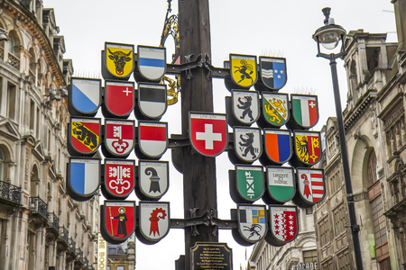 cantons: View of Swiss Cantonal Tree erected 1991 on Leicester Square. This Cantonal Tree displays coats of arms of twentysix cantons of Switzerland.