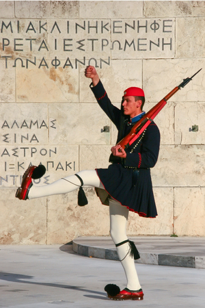 tomb of the unknown soldier: Evzone guarding the Tomb of Unknown Soldier in Athens dressed in service uniform, refers to the members of the Presidential Guard, an elite ceremonial unit. Editorial