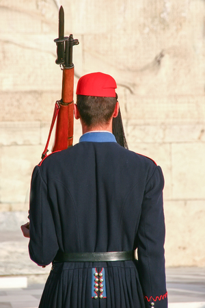 Evzone guarding the Tomb of Unknown Soldier in Athens dressed in service uniform, refers to the members of the Presidential Guard, an elite ceremonial unit. Editorial