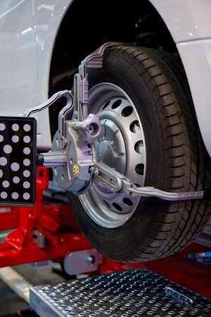 aligning: Wheel with computerized alignment machine clamp
