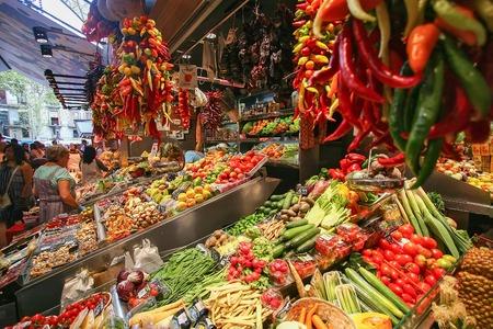 josep: People buying food inside Mercat de Sant Josep de la Boqueria. It is a large public market in the Ciutat Vella district of Barcelona.