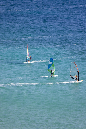 windsurfers: Windsurfing in Vassiliki bay, Lefkada island, Greece