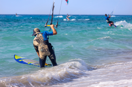 man flying: Kite surfer on the beach Stock Photo