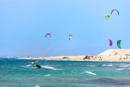 Kitesurfers on the Milos beach in Lefkada island, Greece.