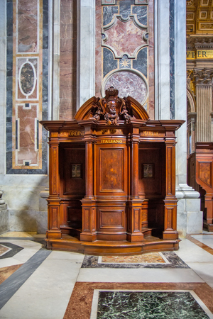 antique booth: Confession room in Vatican Editorial