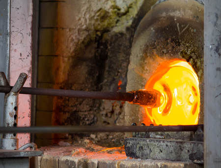 Glass blowing process in the factory