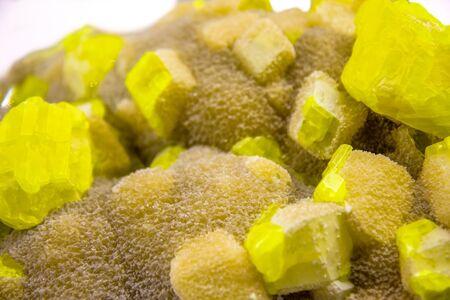 Yellow sulphur on aragonite from Sicily Stock Photo