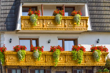 Traditional house with balcony in Slovenia Archivio Fotografico