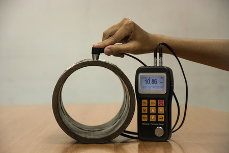 thickness: Inspection wall thickness pipe by ultrasonic thickness test for found internal defect. UTM