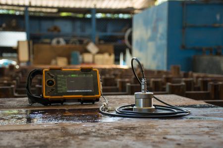 Ultrasonic test to detect imperfection or defect of steel plate in Workshop, NDT Inspection. Reklamní fotografie