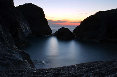 Rocks in the sea at sunset. Picture taken at the Greek island of Kefalonia. photo