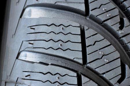 unused: Detail of unused winter car tire. Stock Photo
