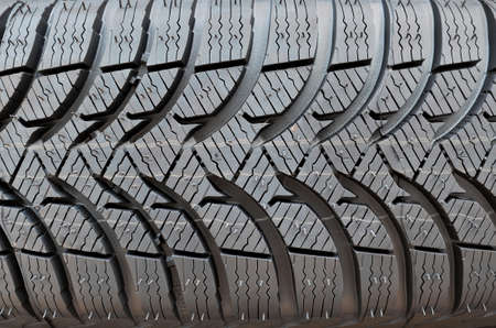 Close up of unused winter car tire. photo
