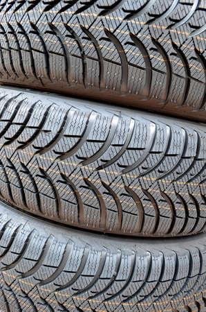 unused: Three unused winter car tires.