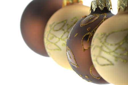 Four brown and golden christmas baubles hanging in  a row  Focus on a second ball  photo