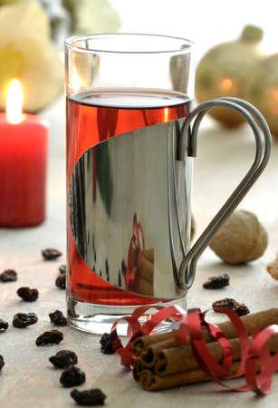 christmas tea: Christmas tea with cinnamon, raisins and other decoration on a wooden background