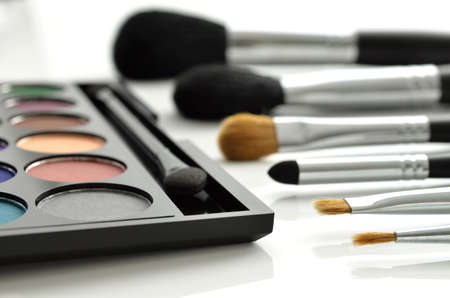 make up brush: Makeup brushes and eye-shadows palette on white background Stock Photo