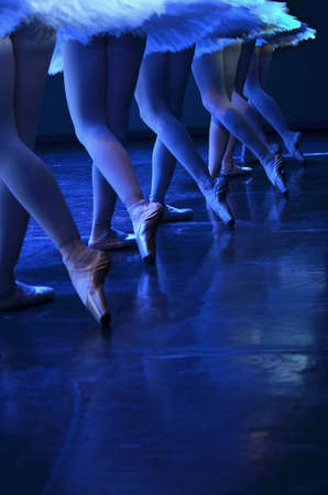 choreography: Ballet performance of Swan lake, detail of ballerinas pointe shoes