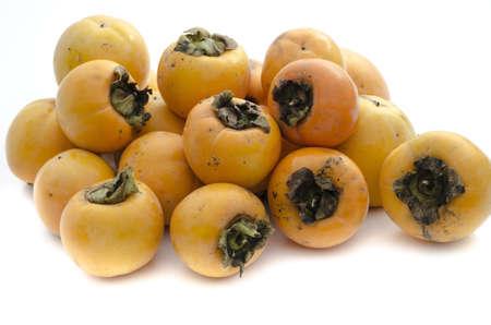 khaki: Bunch of khaki fruit isolated on white background