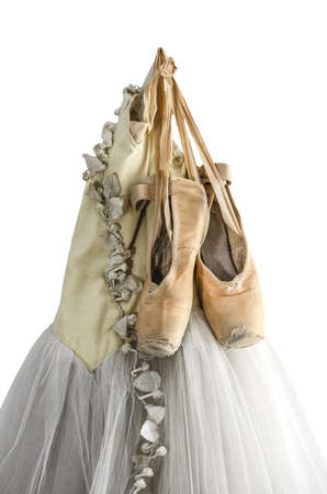 pointe: Hanging tutu and ballet shoes isolated on a white background