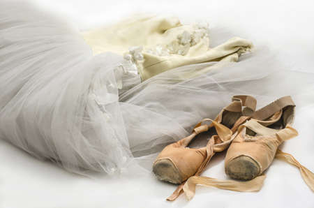 ballet slippers: Ballet dress and old pair of pointe shoes  Stock Photo