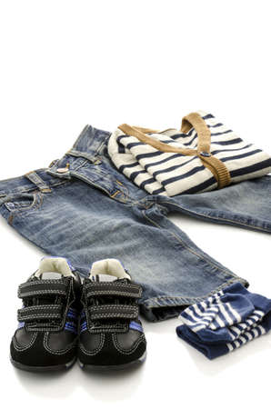 Prepared clothes for a baby boy isolated on a white background  photo