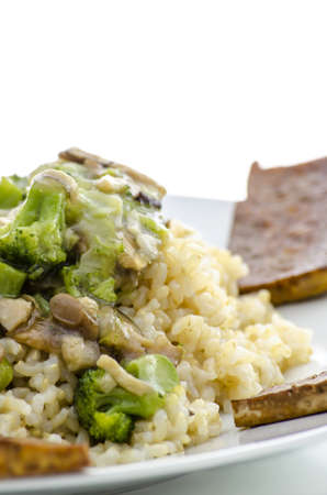 macrobiotic: Healthy macrobiotic food made of rice, mushrooms,vegetable and tofu, served on a white plate